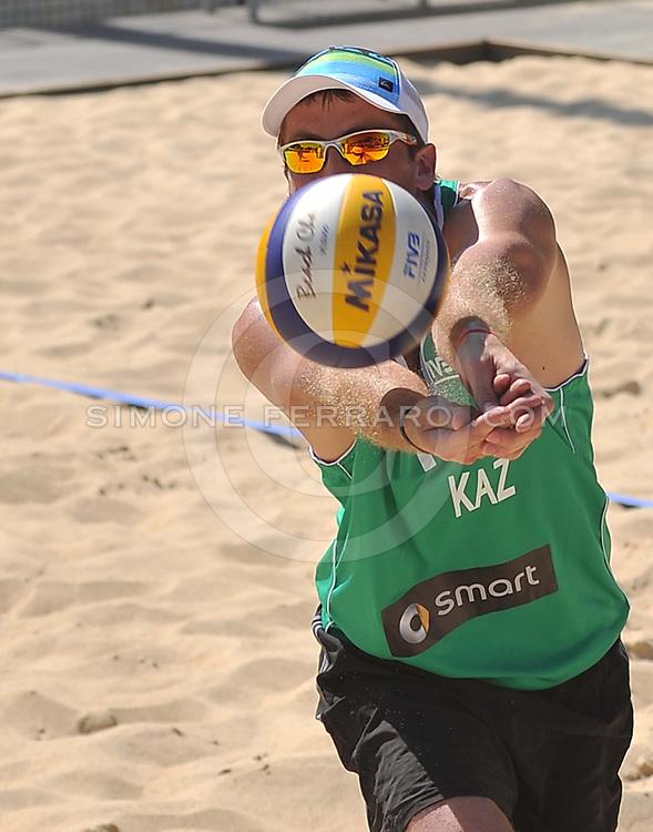 Roma, 20 giugno 2013<br /> Beach Volley Swatch FIVB World Tour - Smart Grand Slam Rome 2013. Foro Italico.<br /> Giorno 3 - Uomini - Secondo turno Pool B<br /> Sidorenko-Dyachenko KAZ vs Cecchini-Morichelli ITA 2-1 (21-15; 16-21; 17-15)<br /> foto di Simone Ferraro / GMT