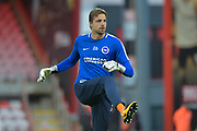 Brighton and Hove Albion goalkeeper Tim Krul (26) warming up during the EFL Cup match between Bournemouth and Brighton and Hove Albion at the Vitality Stadium, Bournemouth, England on 19 September 2017. Photo by Adam Rivers.