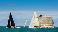 The fleet round the Nab Tower while competing on the Solent off the Isle of Wight during the Panerai British Classic Week, the premier classic yacht regatta in the UK which is now in it's 16th year. <br /> Picture date Monday 10th July, 2017.<br /> Picture by Christopher Ison. Contact +447544 044177 chris@christopherison.com