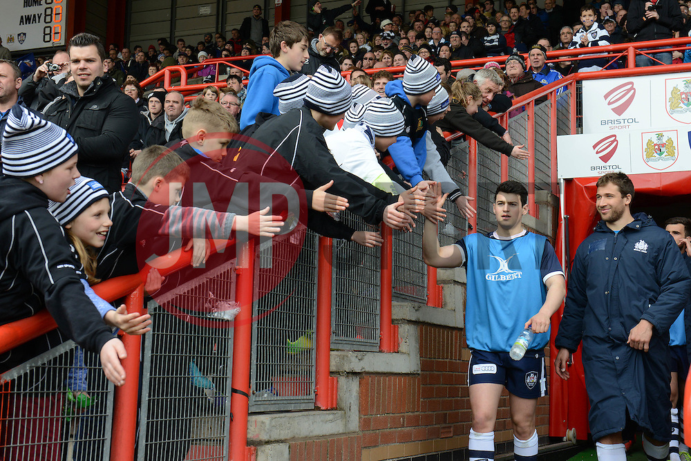 Bristol Rugbys Tim Turner high fives fans as he walks out the tunnel - Photo mandatory by-line: Dougie Allward/JMP - Mobile: 07966 386802 - 29/03/2015 - SPORT - Rugby - Bristol - Ashton Gate - Bristol Rugby v Bedford Blues - Greene King IPA Championship