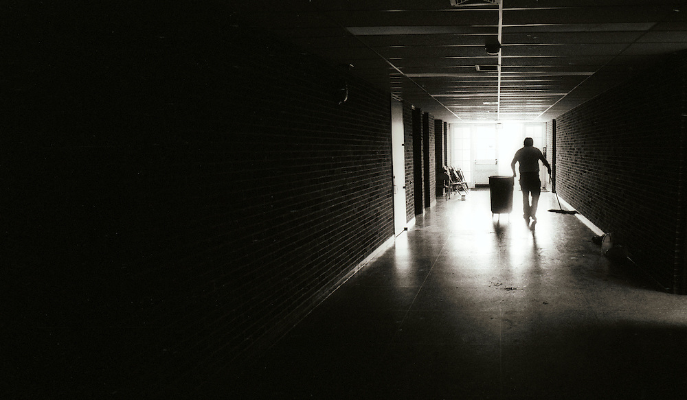 This is a picture I shot when I was in High School, on Long Island. The end of the day, and the janitor was cleaning up.