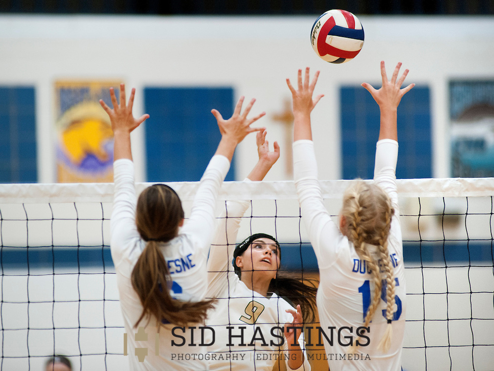 25 AUG. 2015 -- ST. CHARLES, Mo. --St. Piux X High School volleyball player Jena Otec (9) attempts to tip the ball over the defense of Duchesne High School's Molly Sifford (6) and Natalie Schroeder (15) at Duchesne in St. Charles, Mo. Tuesday, Aug. 25, 2015. St. Pius won, 2-0 (25-14, 25-23), to advance to 6-0. It was Duchesne's first match, dropping them to 0-1 on the year. Photo © copyright Sid Hastings.