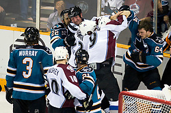 April 22, 2010; San Jose, CA, USA; San Jose Sharks left wing Jamie McGinn (64) fights with Colorado Avalanche defenseman Scott Hannan (third from right) and center Matt Duchene (9) during the second period of game five in the first round of the 2010 Stanley Cup Playoffs at HP Pavilion.  San Jose defeated Colorado 5-0. Mandatory Credit: Jason O. Watson / US PRESSWIRE