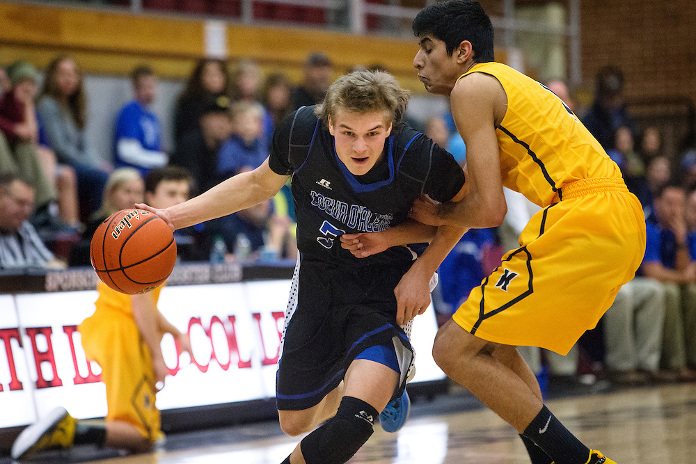 GABE GREEN/Press<br /> <br /> Coeur d&rsquo;Alene guard Ryan Walde breaks through the defense of a Kelowna High School player Friday during the second night of the Coeur d&rsquo;Alene Inn-Vitational.