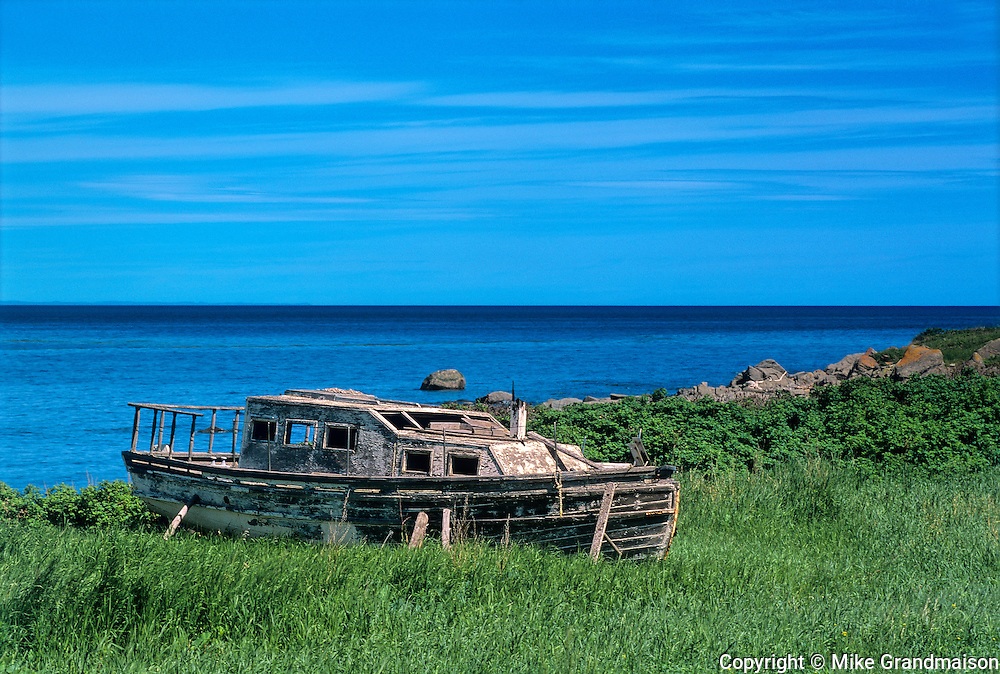 Old wooden fishing boat on shore of Gulf of St. Lawrence<br /> Ste-Félicité<br /> Quebec<br /> Canada