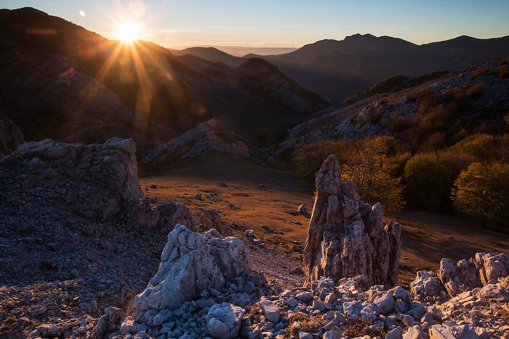 "Sunset over the mountains overlooking the Crovu Porcului (""Pig valley""). Mehedinti Plateau Geopark, Geoparcul Platoul Mehedinți, Romania."