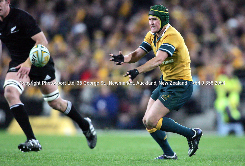 Matt Giteau passes during the Bledisloe Cup match between the All Blacks and the Wallabies at Telstra Stadium, Sydney, Australia on Saturday 13 August, 2005. The All Blacks won the match, 30 - 13. Photo: Hannah Johnston/PHOTOSPORT<br />