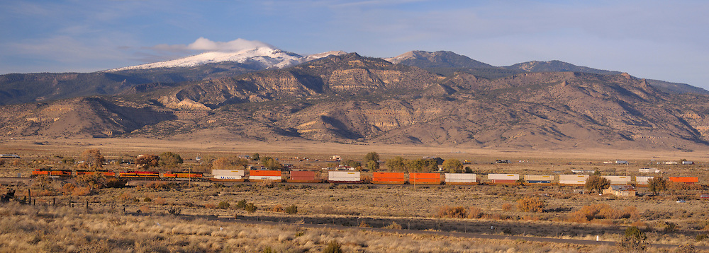 Train and snow covered Mountains, San Fidel, New Mexico, USA