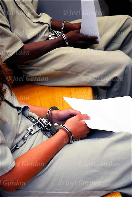 African and Hispani American juveniles are disproportionate minority that are confined and  handcuffed waiting to be called by the judge
