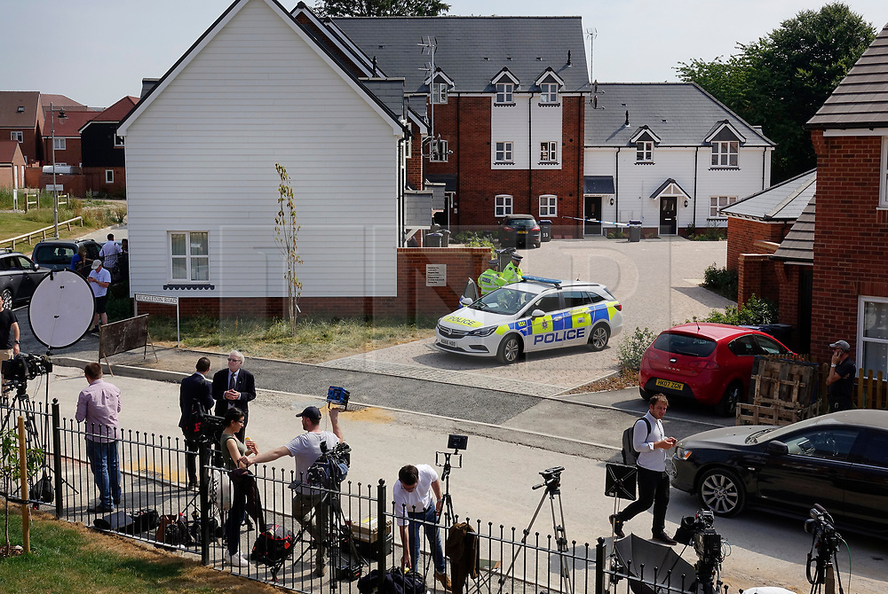 © Licensed to London News Pictures. 04/07/2018. Amesbury, UK. TV crews and reporters gather as police stand at the entrance of a property in Muggleton Road, Amesbury after a couple named locally as Dawn Sturgess, 44, and her partner Charlie Rowley, 45, were taken ill on Saturday 30th June 2018. Police have confirmed that the couple have been in contact with Novichok nerve agent. Former Russian spy Sergei Skripal and his daughter Yulia were poisoned with Novichok nerve agent in nearby Salisbury in March 2018.Photo credit: Peter Macdiarmid/LNP