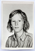 school memory photo of young teenager boy looking at the camera