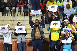 Durban, SOUTH AFRICA - SEPTEMBER 19: Fans holding placards during the Absa Premiership match between Golden Arrows and Mamelodi Sundowns at Princess Magogo Stadium on September 19, 2018 in Durban, South Africa. (Photo by Motshwari Mofokeng/ANA)