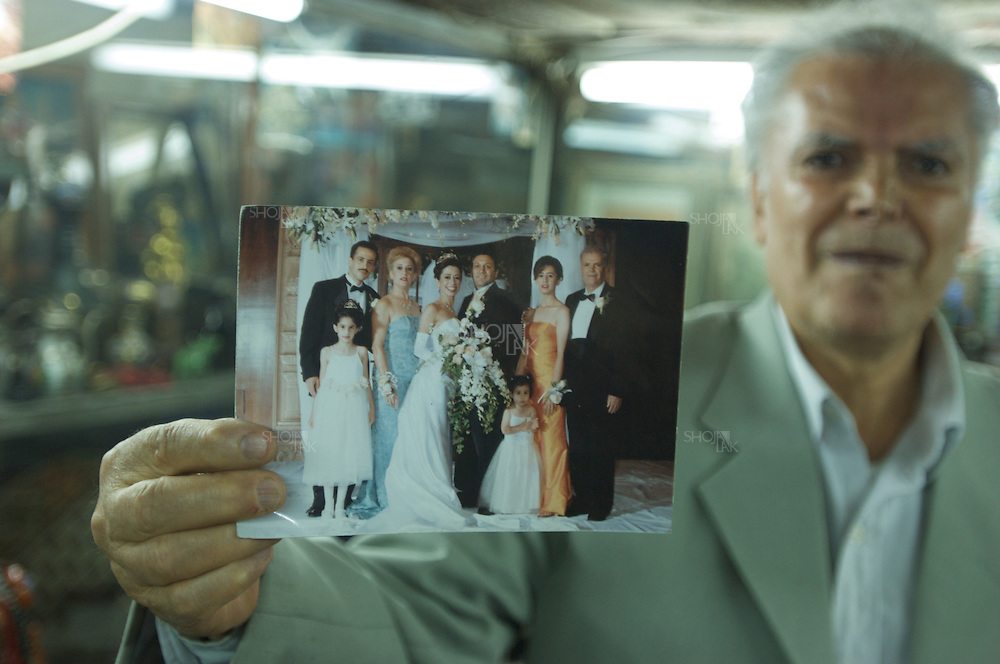 Tehran, Iran, April 2008. Moses baba Famous Antique dealer showing his daughter's wedding picture in USA.