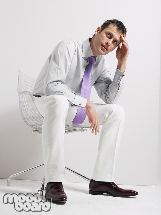 Anxious Businessman Sitting in Swivel Chair