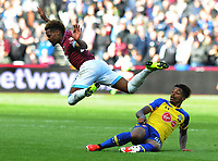 Football - 2018 / 2019 Premier League - West Ham United vs. Southampton<br /> <br /> Arthur Masuaku of West ham rides a tackle from Mario Lemina, at The London Stadium.<br /> <br /> COLORSPORT/ANDREW COWIE