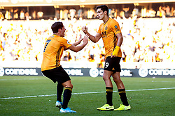 Raul Jimenez of Wolverhampton Wanderers celebrates with Pedro Neto of Wolverhampton Wanderers after scoring a goal to make it 1-1 - Mandatory by-line: Robbie Stephenson/JMP - 25/08/2019 - FOOTBALL - Molineux - Wolverhampton, England - Wolverhampton Wanderers v Burnley - Premier League
