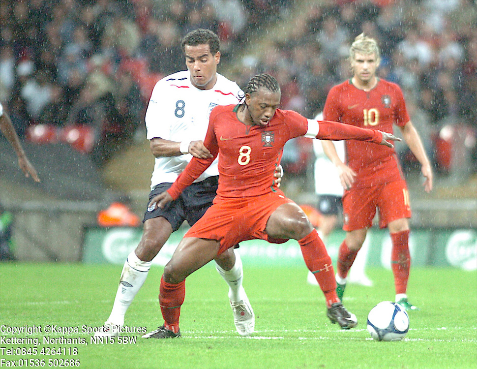 ENGLANDS TOM HUDDLESTON HOLDS OF PORTUGALS MANUEL FERNANDES England-Portugal Under 21s, EEFA EUROPEAN Under 21 Championship, Wembley Stadium 5th September 2008