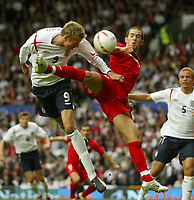 Photo: Aidan Ellis.<br /> England v Andorra. European Championships 2008 Qualifying. 02/09/2006. England's Peter Crouch gets in a header in front of Andorra's Marcio Vieira