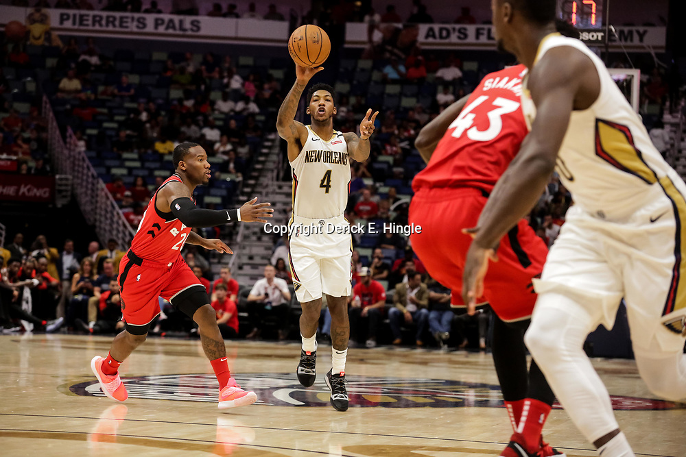 Oct 11, 2018; New Orleans, LA, USA; New Orleans Pelicans guard Elfrid Payton (4) passes to forward Julius Randle (30) during the first half against the Toronto Raptors at the Smoothie King Center. Mandatory Credit: Derick E. Hingle-USA TODAY Sports