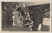 Kabuki actors with main character wrestling a snapping turtle and other actors dressed in catfish, octopus and lobster costumes, 1920s, silver gelatin bromide post card.<br />