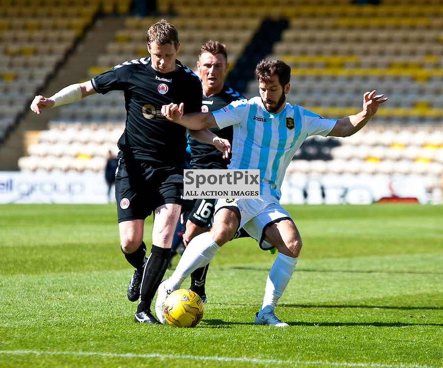Livingston v Clyde; Scottish League Cup 1st Round, 1st August 2015; Clyde's Scott McLaughlin tackles Livingston's Liam Buchanan during the Livingston v Clyde Scottish League Cup 1st round match played at Almondvale Stadium; © Chris Johnston | SportPix.org