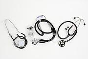 Three stethoscopes on white background