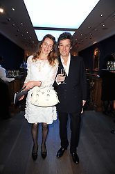 Artist EMMA SERGEANT and her husband ADAM ZAMOYSKA at an auction and priavte view of paintings, drawings, stories and doodles by well known personalities held at Christie's, St.James's, London on 20th September 2010.