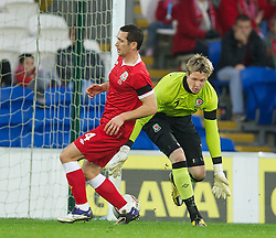 12.11.2011, City Stadion, Cardiff, ENG, FSP, Wales (ENG) vs Norwegen (NOR), im Bild Wales' goalkeeper Wayne Hennessey and Andrew Crofts combine to hand Norway their first goal during the international friendlies football match, between Wales (ENG) and Norway (NOR) at City Stadium, Cardiff, United Kingdom on 12/11/2011. EXPA Pictures © 2011, PhotoCredit: EXPA/ Sportida/ David Rawcliff..***** ATTENTION - OUT OF ENG, GBR, UK *****