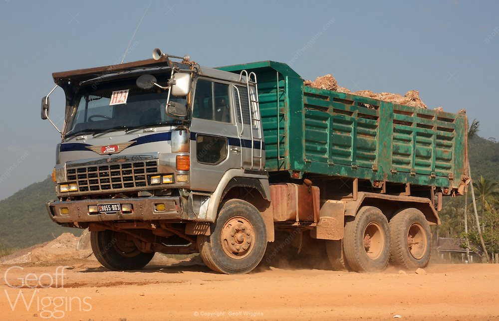 Cambodian dump truck transporting rock during road construction work near Kampot in southern Cambodia