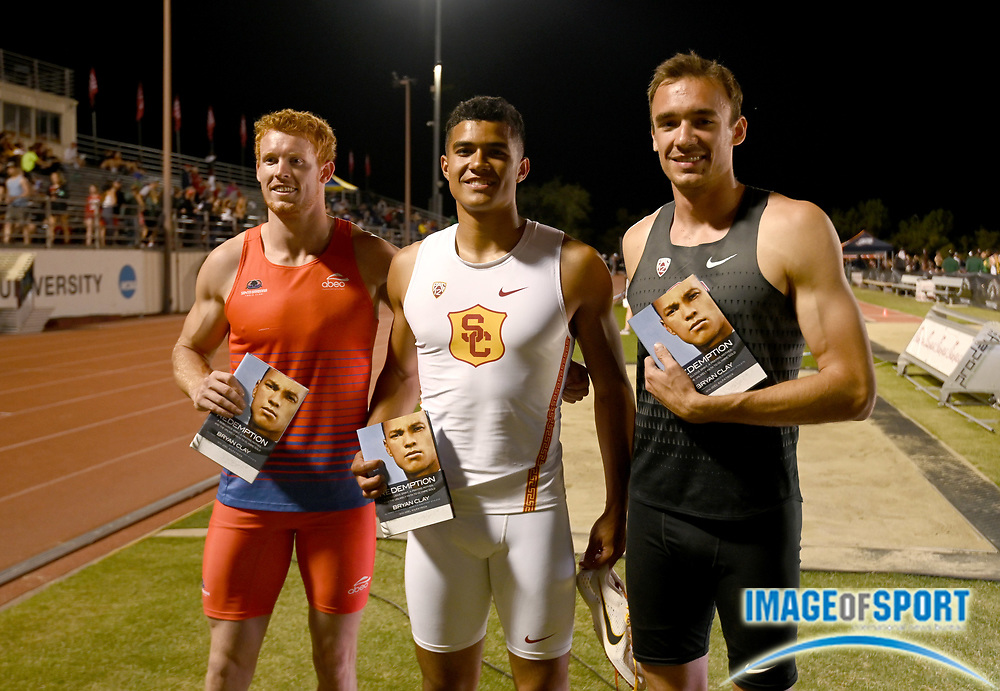 Apr 18, 2019; Azusa, CA, USA; Decathlon winner Ayden Owens of Southern California (center) poses with runner-up Harrison Williams of Stanford (right) and third-place finisher Timothy Ehrhardt at the Bryan Clay Invitational at Azusa Pacific University.