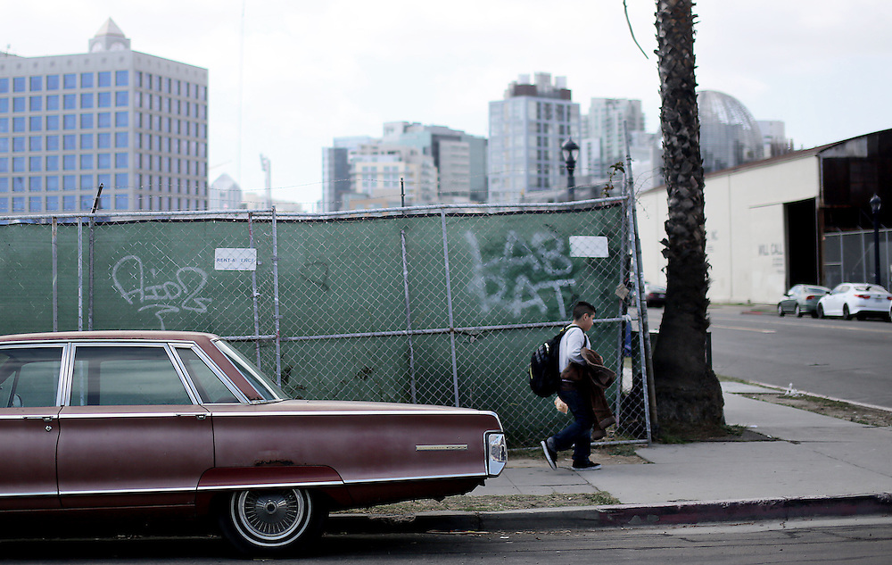 A student from the Monarch School walks home after school in Downtown San Diego, CA on Monday, May 18, 2015.  The Monarch School is the largest elementary through High School facility that caters to students that are homeless or are have associations with homelessness.(Photo by Sandy Huffaker for The Atlantic)