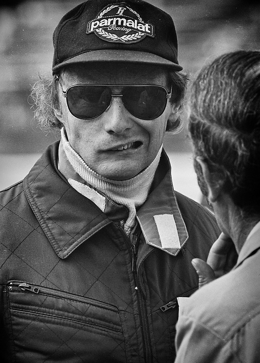 Before the start of the 1978 United States Grand Prix, two-time Austrian World Champion Niki Lauda reacts to news from his mechanic, and good friend Ermanno Cuoghi, that his Brabham-Alfa Romeo has an oil leak from a porous block casting and probably will not finish the race. <br />
