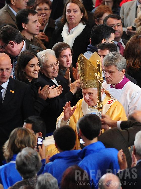 Pope Benedict XVI salutes as he arrives at Sagrada Familia to celebrate a mass, on november 7, 2010, in Barcelona. Benedict visits Barcelona to consecrate Barcelona's famous temple, the Sagarada Famila church.  PHOTO/Rafa Rivas