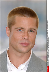 US actor and cast member Brad Pitt poses at the photocall for Wolfgang Petersen's film 'Troy' as part of the 57th Cannes Film Festival in Cannes-France on Thursday, May 13, 2004. Photo by Hahn-Nebinger-Gorassini/ABACA.  Cannes Film Festival Festival de Cannes Festival du Film de Cannes Pitt Brad Troy Presentation de film Presentation de serie Movie Screening<br /> Photocall<br /> Photo call Seule Seul Seuls Seules Alone Cannes France Frankreich Provence-Alpes-Côte d'Azur Provence-Alpes-Cote d'Azur Headshot Portraits Portrait Headshots Head Shot Head Shots Vertical Vertical  | 60032_15