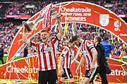 Elliot Whitehouse of Lincoln City (4) celebrates winning the Checkatrade Trophy during the EFL Trophy Final match between Lincoln City and Shrewsbury Town at Wembley Stadium, London, England on 8 April 2018. Picture by Stephen Wright.
