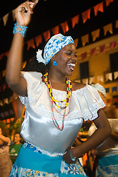 Sao Luis, MA, Brasil    16/Jun/2006.Tambor de Crioula  - Grupo Mara Crioula. Tradicao de origem africana, danca sensual praticada por mulheres que evoluem em torno de 3 tipos de tambores. Grupos se apresentam nos festejos juninos, embora nao exclusivamente  / Tambor da Crioula: Afro-Brazilian dance in which gaily glad women court a row of drums. Whirling and gyrating in time to the music they negotiate for prime position in the centre of the drums..Foto Marcos Issa/Argosfoto