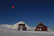 Tethered weather blimp floats above the French-German AWIPEV research station in the international science village of Ny-Alesund on Spitsbergen island in Kongsfjorden; Svalbard, Norway.