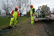 Alex Faucher and Jared Vobornik of Pipe-Eye Sewer clean a manhole in Lockport, New York on Friday, December 4, 2015. Pipe-Eye is based in Bradford, Pennsylvania.