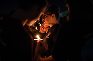 Members of the Stoneman Douglas Eagle Regiment mourn among thousands of other community members during a candlelight vigil at the Pine Trails Park amphitheater Thursday, Feb. 15, 2018, a day after the mass shooting at Marjory Stoneman Douglas High School in Parkland. (XAVIER MASCAREÑAS/TREASURE COAST NEWSPAPERS)