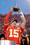 Kansas City Chiefs quarterback Patrick Mahomes holds the Lamar Hunt Trophy as he celebrates winning the NFL AFC Championship football game against the Tennessee Titans, Sunday, Jan. 19, 2020, in Kansas City, MO. The Chiefs won 35-24 to advance to Super Bowl 54. (Photo/Colin E. Braley)