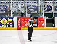 Referee Andrew Wilk signals a holding penalty during the game at the Cedar Rapids Ice Arena, 1100 Rockford Road SW in Cedar Rapids on Saturday evening, February 18, 2012. (Stephen Mally/Freelance)