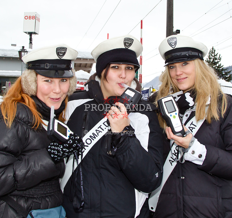 "22.01.2012, Ganslernhang, Kitzbuehel, AUT, FIS Weltcup Ski Alpin, 72. Hahnenkammrennen, Herren, Slalom, im Bild ""Alkomat-Polizistinnen"" // Policegirls with Electronic Alkohol Machines during Slalom race of 72th Hahnenkammrace of FIS Ski Alpine World Cup at 'Ganslernhang' course in Kitzbuhel, Austria on 2012/01/22. EXPA Pictures © 2012, PhotoCredit: EXPA/ Markus Casna"