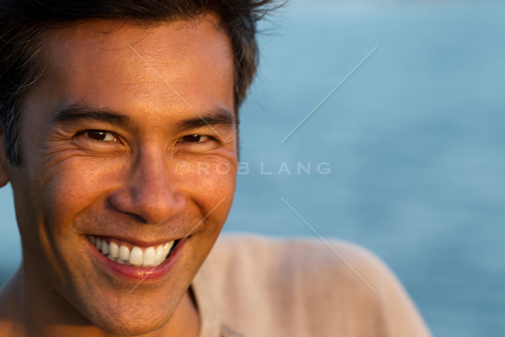 Asian American man with a big smile