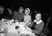 """A special screening of the battle scenes from the film 'The Blue Max'  at Ardmore Studios, Bray, Co. Wicklow.  Engaged-George Peppard pictured with his fiancé, U.S. actress Elisabeth Ashley, on the set of the production during a champagne and lobster lunch-break. Peppard is in the uniform of a World War 1 German fighter """"Bruno Stachel'.  Also pictured is German actress Loni von Friedl..16.09.1965"""