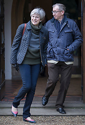 © Licensed to London News Pictures. 19/02/2017. Reading, UK. British Prime Minister THERESA MAY and her husband PHILIP attend church in her constituency in Berkshire, England. Photo credit: Peter Macdiarmid/LNP