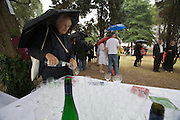 Austrian Pavillion opening ceremony. Tasting Austrian wines in the rain; star architect Hans Hollein helping himself to a glass of water.
