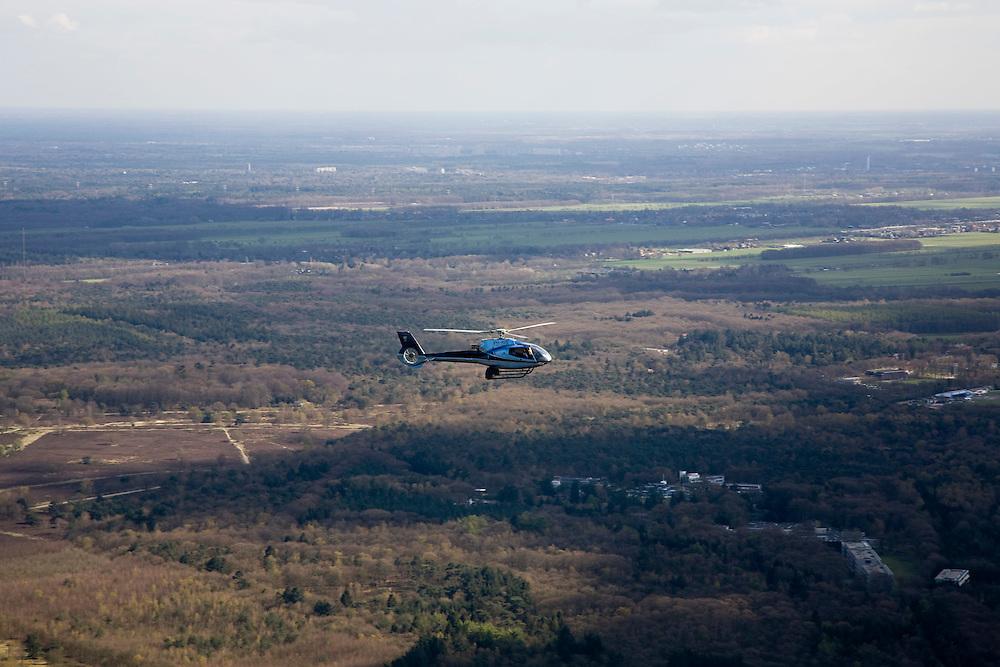Nederland, Noord-Holland, Hilversum, 16-04-2008; helikopter  van het type Eurocopter EC130 boven het vliegveld en de hei van Hilversum; VIP vervoer, prive jet, privejet, prive vervoer..luchtfoto (toeslag); aerial photo (additional fee required); .foto Siebe Swart / photo Siebe Swart