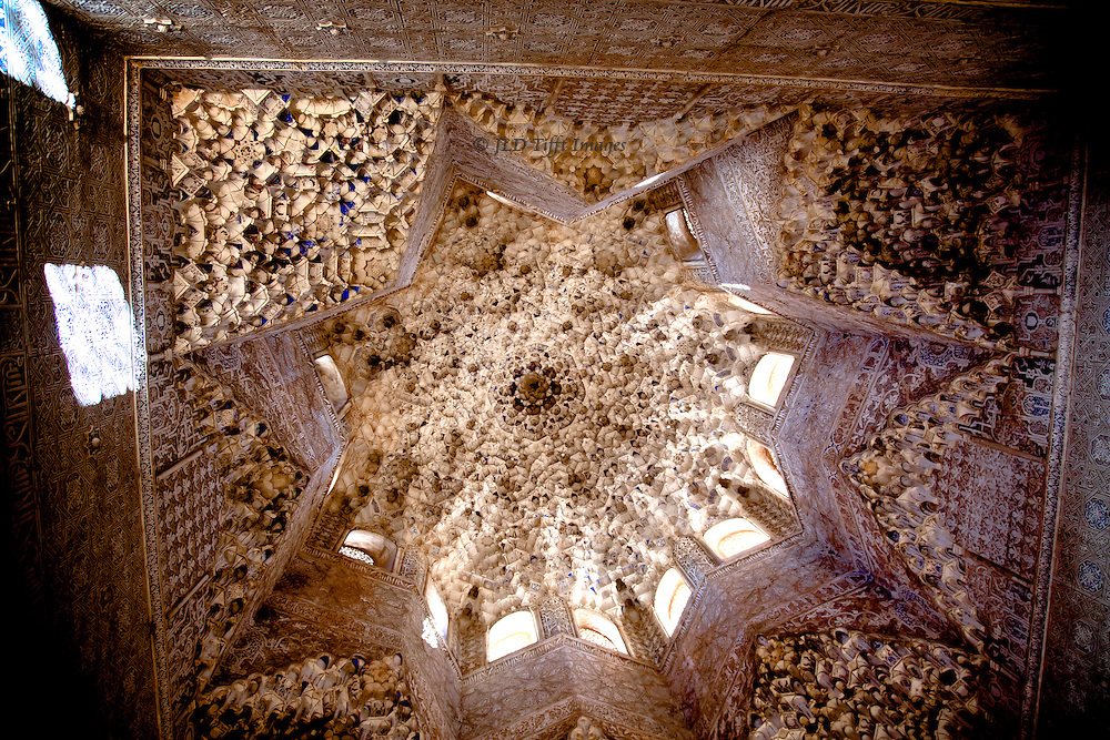 Sala de los Abencerrajes, dome interior with Nasrid decoration in white plaster.  Its beauty belies the legend that a family rivalling Boabdil was massacred here.