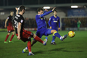 AFC Wimbledon midfielder Dannie Bulman (4) blocks Coventry City midfielder Kevin Foley (21) during the EFL Sky Bet League 1 match between AFC Wimbledon and Coventry City at the Cherry Red Records Stadium, Kingston, England on 14 February 2017. Photo by Stuart Butcher.