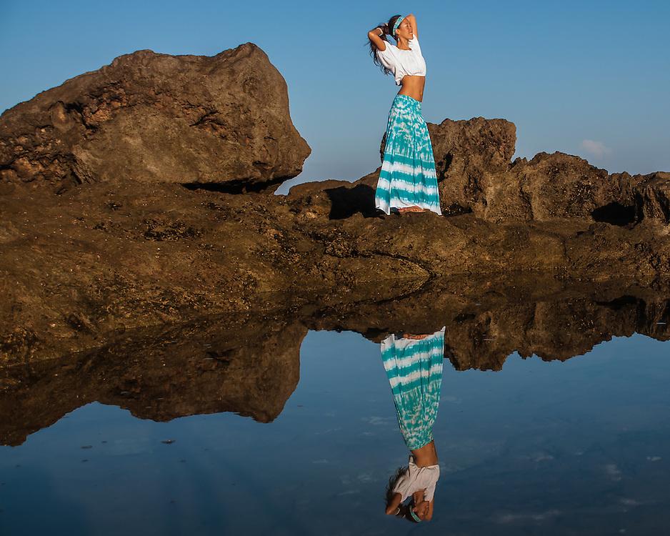 Woman by tide pool looking ahead, transformation, noelani studios noelani love